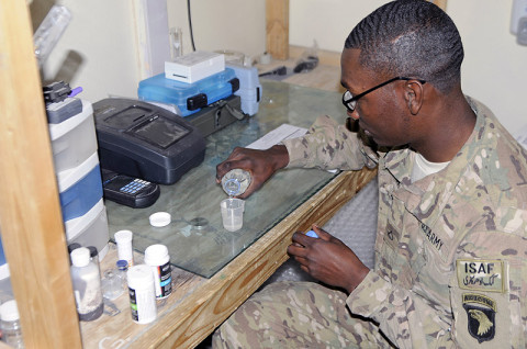 U.S. Army Pfc. Demetrius Roberson, a preventive medicine medic with Company C, 426th Brigade Supoprt Battalion, 1st Brigade Combat Team, 101st Airborne Division, pours water into a measuring cup to begin testing its quality Dec. 17th, 2012, on Forward Operating Base Fenty, Afghanistan. Preventive medicine medics routinely check water, food and other hazards around FOBs to prevent disease and bodily injuries and ensure the health and safety of Soldiers. (U.S. Army photo by Sgt. Jon Heinrich, Task Force 1-101 PAO)