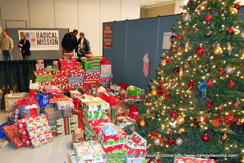 "Christmas presents flowed out from under the Christmas Tree at the Radical Mission ""Warm Souls Christmas Celebration"" held Christmas eve."