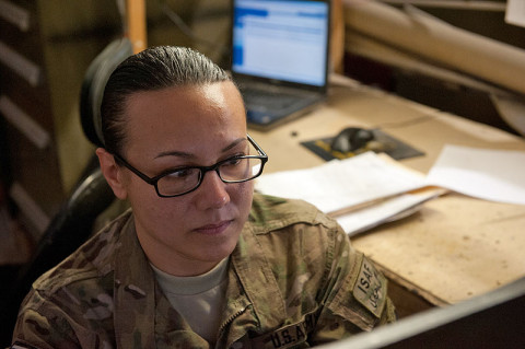 Spc. Jennifer Benevente, an avionics repair specialist with D Troop, 2nd Squadron, 17th Cavalry Regiment, reviews wiring schematics for a helicopter in order to determine the best way to test for electrical issues at Forward Operating Base Fenty, Afghanistan, Dec. 6th, 2012. (U.S. Army photo by Sgt. Duncan Brennan, 101st CAB Public Affairs)