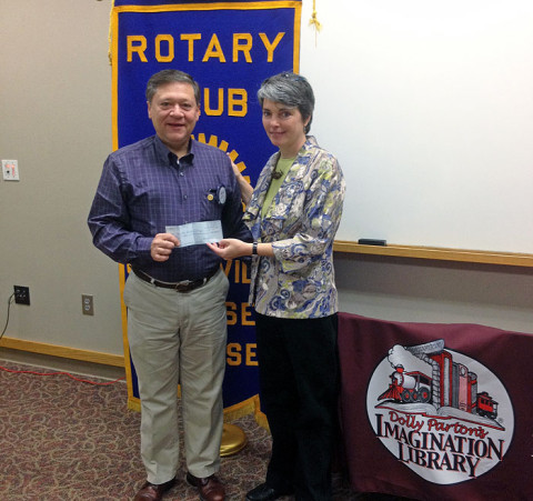 Montgomery County Imagination Library receives $1,000 check from Sunrise Rotary Club