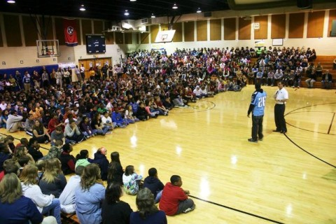 Jerry Blessing and Jordan Babineaux talking to the Students of Northeast Middle School. (Photo by Tennessee Titans staff)
