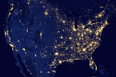 "This image of the continental United States at night is a composite assembled from data acquired by the Suomi NPP satellite in April and October 2012. The image was made possible by the satellite's ""day-night band"" of the Visible Infrared Imaging Radiometer Suite (VIIRS), which detects light in a range of wavelengths from green to near-infrared and uses filtering techniques to observe dim signals such as city lights, gas flares, auroras, wildfires and reflected moonlight. (Credit: NASA Earth Observatory/NOAA NGDC)"