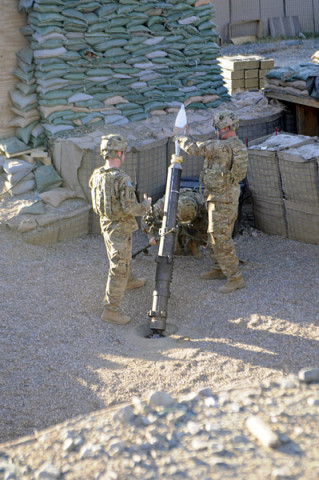 Staff Sgt. Christopher Dollar, a native of Yakima, Wash., loads a 120mm illumination mortar round during outgoing fire training Dec. 2, 2012, at FOB Joyce, Afghanistan. Dollar is a gunnery sergeant with Battery A, 2nd Battalion, 320th Field Artillery Regiment, 1st Brigade Combat Team, 101st Airborne Division, and is currently a mortar crew member with 2nd Battalion, 327th Infantry Regiment, 1st BCT at Joyce. (U.S. Army photo by Sgt. Jon Heinrich, Task Force 1-101 PAO)
