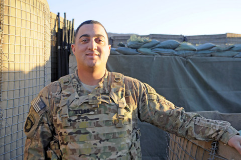 U.S. Army Staff Sgt. Christopher Dollar, from Yakima, Wash., smiles after having completed outgoing fire training with 120mm mortars Dec. 2, 2012, at FOB Joyce, Afghanistan. Dollar is a gunnery sergeant with Battery A, 2nd Battalion, 320th Field Artillery Regiment, 1st Brigade Combat Team, 101st Airborne Division, and is currently a mortar crew member with 2nd Battalion, 327th Infantry Regiment, 1st BCT at Joyce. (U.S. Army photo by Sgt. Jon Heinrich, Task Force 1-101 PAO)