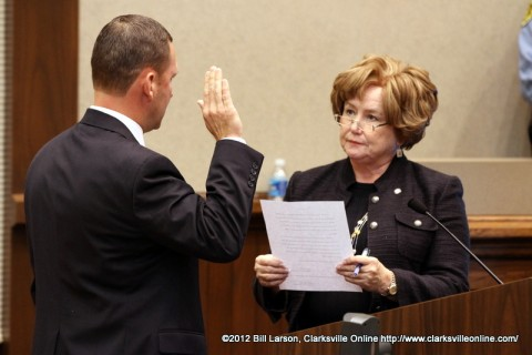 John Fuson being sworn into office by Montgomery County Mayor Carolyn Bowers.
