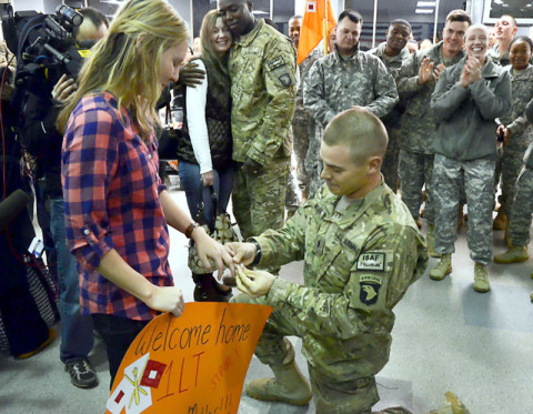 First Lt. Mathew Miller places an engagement ring on the finger of his girlfriend, Caitlain Stein, moments after returning from his deployment to Afghanistan during a welcome home ceremony, Dec. 13, at Fort Campbell.  (U.S. Army Photo)