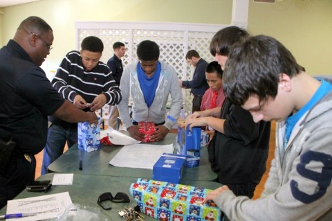 Clarksville Police Department's Youth Coalition wrap presents for residents of Spring Meadows Health Care Center.
