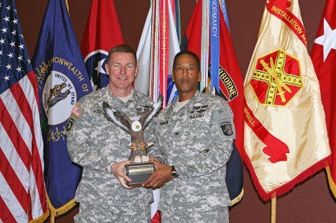 "Maj. Gen. James C. McConville, the commander of the 101st Airborne Division (Air Assault) handed Col. Charles R Hamilton, the commander of the 101st Sustainment Brigade ""LifeLiners"" the Combined Federal Campaign trophy that gets held in the headquarters of the recognized organization until the next years ceremony. The ceremony was held January 22nd on Fort Campbell, KY. (U.S. Army photo by: Sgt. 1st Class Mary Rose Mittlesteadt, 101st Sustainment Brigade.)"