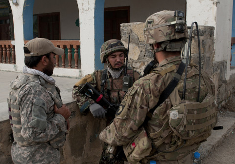 "Afghan National Army Staff Sgt. Abdul Rahman an infantryman with 3rd Coy, 3rd Kandak, 1st Brigade, 203rd Corps, tells U.S. Army 1st Lt. Jack Abate, the platoon leader for 2nd Platoon, Company B, 3rd Battalion, 187th Infantry Regiment, 3rd Brigade ""Rakkasans,"" 101st Airborne Division (Air Assault), how the ANA has established security around the village of Nakam in Khowst Province, Afghanistan, Jan. 11, 2013. The patrol was conducted to enroll local Afghans into the Secure Electronic Enrollment Kit. (Spc. Alex Kirk Amen/U.S. Army)"