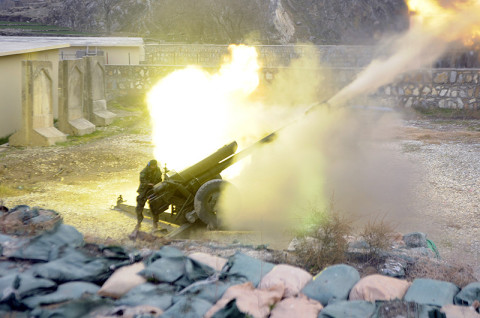 An Afghan National Army artilleryman fires his 122 mm D-30 Howitzer Dec. 26, at Combat Outpost Nanglam. The ANA artillery fired fire missions in support of their soldiers and U.S. Army soldiers from Security Forces Assistance and Advisory Team-6, 1st Brigade Combat Team, 101st Airborne Division as they resupplied Chapah Darah.