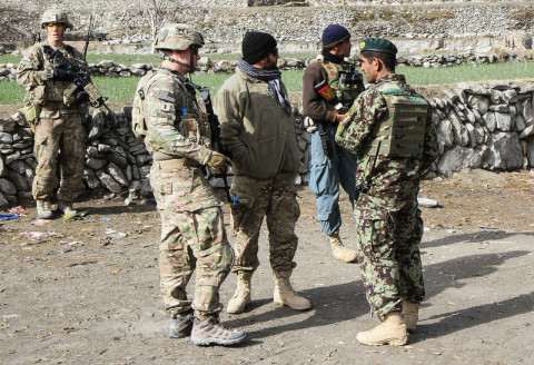 "1st Lt. Trenton Wiggins, a platoon Leader for 2nd Platoon, Troop C, 1st Squadron, 33rd Cavalry Regiment, 3rd Brigade Combat Team ""Rakkasans,"" 101st Airborne Division (Air Assault), discusses with Afghan National Army Soldiers the possible ways of conducting a mission in Nadir Shah Kot District, Afghanistan, Jan. 12, 2013. The mission was aimed at gathering information from village elders and to disrupt possible insurgent activity in the area. (Spc. Brian Smith-Dutton/U.S. Army)"