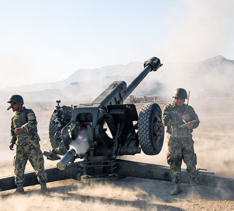 """A Soldier assigned to 3rd Battalion 320th Field Artillery Regiment, 3rd Brigade Combat Team """"Rakkasans"""", 101st Airborne Division,(Air Assault), oversees a live-fire exercise conducted by the Afghan National Army's 203rd Corps, 1st Infantry Brigade, 4th Kandak, D-30 Heavy Coy at Camp Parsa, Afghanistan, Jan. 9, 2013. (U.S. Army photo by Spc. Brian Smith-Dutton, Task Force 3/101 Public Affairs)"""