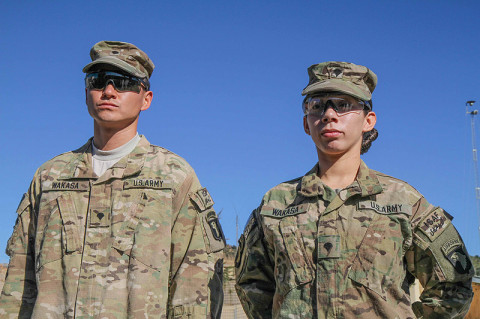 "U.S. Army Sgt. Lizeth Wakasa (right), a food service specialist assigned to Headquarters Company, 3rd Battalion, 187th Infantry Regiment, 3rd Brigade Combat Team ""Rakkasans,"" 101st Airborne Division (Air Assault), stands proud before her promotion to sergeant with her husband U.S. Army Spc. David Wakasa (left), also a food service specialist with Headquarters, 3-187, at Combat Outpost Bowri Tana, Dec. 1st, 2012.  (U.S. Army photo by Sgt. 1st Class Abram Pinnington, Task Force 3/101 Public Affairs)"