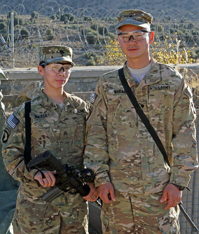 "U.S. Army Sgt. Lizeth Wakasa (left), a food service specialist assigned to Headquarters Company, 3rd Battalion, 187th Infantry Regiment, 3rd Brigade Combat Team ""Rakkasans,"" 101st Airborne Division (Air Assault), stands proudly by her husband U.S. Army Spc. David Wakasa (right), also a food service specialist with Headquarters, 3-187, at Combat Outpost Bowri Tana, Dec. 1st, 2012. (U.S. Army photo by Sgt. 1st Class Abram Pinnington, Task Force 3/101 Public Affairs)"