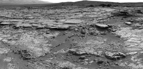 "The sinuous rock feature in the lower center of this mosaic of images recorded by the NASA Mars rover Curiosity is called ""Snake River."" The images in the mosaic were taken by Curiosity's Navigation Camera during the 133rd Martian day, or sol, of the rover's mission on Mars (Dec. 20th, 2012). (Image Credit: NASA/JPL-Caltech)"