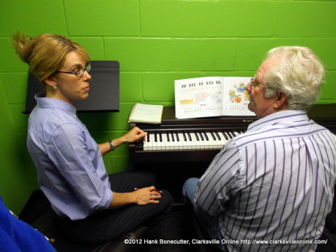 Kim Edmondson teaching Gene Belt the piano
