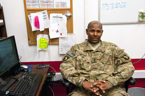 "First Sgt. Arthur Rizer, E Troop, 2nd Squadron, 17th Cavalry Regiment, poses with letters and cards from his family at Forward Operating Base Fenty, Afghanistan, Dec. 11th, 2012. ""Soldiers trust me to guide them,"" said Rizer. (U.S. Army photo by Sgt. Duncan Brennan, 101st CAB public affairs)"