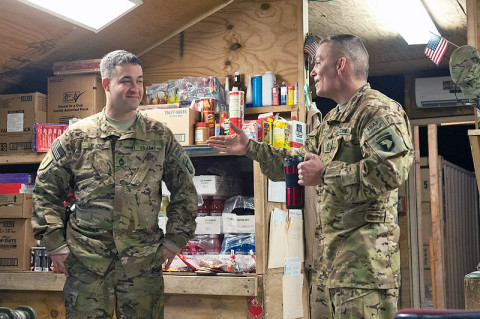 First Sgt. Bryan Kipp, B Company, 6th Battalion, 101st Combat Aviation Brigade, catches up with Staff Sgt. Christopher Salmond, B, 6-101 CAB platoon sergeant during battlefield circulation at Forward Operating Base Fenty, Afghanistan Dec. 22nd, 2012. First sergeants use battlefield circulations to make sure that their soldiers have everything they need when companies are split between different task forces. (U.S. Army photo by Sgt. Duncan Brennan, 101st CAB public affairs)