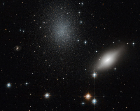 This image of galaxies NGC 5011B and NGC 5011C in the Constellation of Centaurus was taken with Hubble's Advanced Camera for Surveys using visual and infrared filters. (ESA/Hubble & NASA)