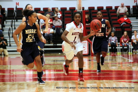 Tiasha Gray of the APSU Lady Gov's drives the ball up against a tough Murray State Racer Defense