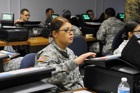 "Spc. Mayra I. Ruiz Herrera, a human resource specialist with 3rd Platoon, 101st Human Resource Company, 101st Sustainment Brigade ""LifeLiners,"" types on the Intergrated Retail Terminal machine during a Postal Operations course at Fort Campbell, KY, Dec. 12th, 2012. The Postal Operations course trains the soldiers on how to operate a post office while deployed or overseas. (Photo by Sgt. Sinthia Rosario)"