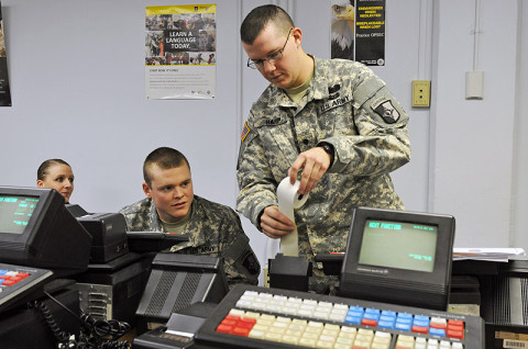 "Spc. Nathaniel W. Harp, a human resource specialist with 2nd Platoon, 101st Human Resource Company, 101st Sustainment Brigade ""LifeLiners,"" inserts receipt paper into the Intergrated Retail Terminal machine during a Postal Operations course at Fort Campbell, KY, Dec. 12th, 2012. The Postal Operations course trains the soldiers on how to operate a post office while deployed or overseas. (Photo by Sgt. Sinthia Rosario)"
