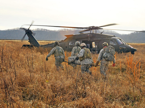 Soldiers from the 7-101st GSAB, 159th CAB, 101st Airborne Division and Airmen from 19th ASOS, Fort Campbell, KY, conduct joint Medevac training at Fort Knox, KY. This training served to sharpen the skills of the service members. (Photo by Capt. John Giaquinto)