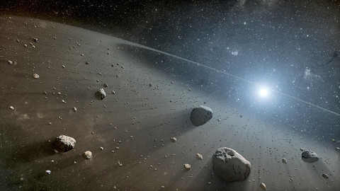 This artist's concept illustrates an asteroid belt around the bright star Vega. (Image credit: NASA/JPL-Caltech)