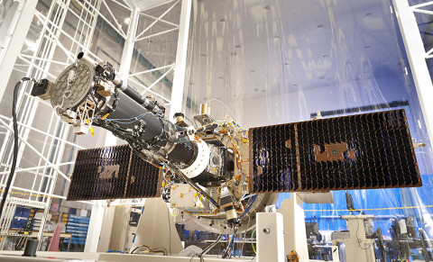 The fully integrated spacecraft and science instrument for NASA's Interface Region Imaging Spectrograph (IRIS) mission is seen in a clean room at the Lockheed Martin Space Systems Sunnyvale, CA facility. The solar arrays are deployed in the configuration they will assume when in orbit. (Credit: Lockheed Martin)