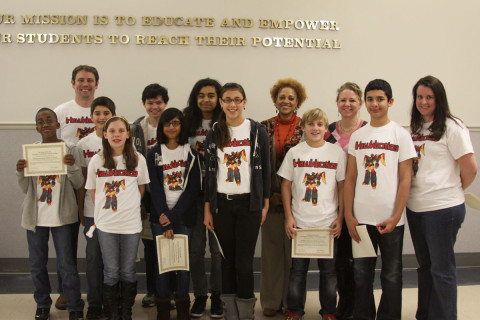 Rossview Middle School's Hawktronics Robotics Team with coaches Jason Pierschbacher and Bridget Harding and Assistant Principal Rosalyn Williams.