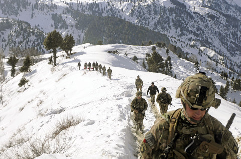 Afghan Border Police and U.S. Army Soldiers from ABP Zone 1, 1st Brigade Combat Team, 101st Airborne Division, hike from their landing zone to Observation Point 12 along the Afghanistan-Pakistan border, Jan. 21st, 2013. (U.S. Army Photo by Sgt. Jon Heinrich, CT 1-101 Public Affairs)