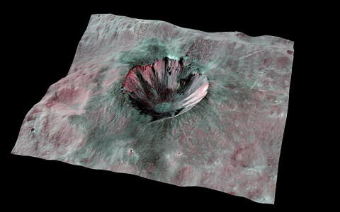 This composite-color view from NASA's Dawn mission shows Cornelia Crater, streaked with dark materials, on the giant asteroid Vesta. (Image credit: NASA/JPL-Caltech/UCLA/MPS/DLR/IDA)