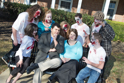 APSU associate professor of history Dr. Antonio Thompson and his wife, APSU associate professor of biology Dr. Amy Thompson, discuss the zombie apocalypse with APSU students dressed as zombies. The students include Richard Borges, Kylee Dick, Amanda Gruver, Raistlin Delisle, Maja Paro, Eric Roberts, and Dustin Waters. (Photo by Beth Liggett/APSU staff)