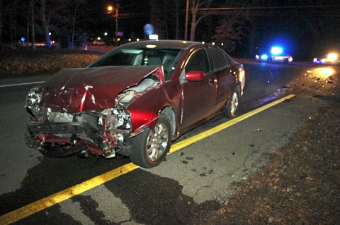 2006 Mitsubishi Galant crashed into a 2000 Lincoln LS on Purple Heart Highway. The Lincoln rolled through a stop sign and into the path of the oncoming Galant.