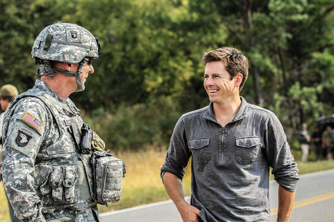 "Maj. Gen. James C. McConville, commanding general of the 101st Airborne Division (Air Assault) and Fort Campbell, Ky., shares a laugh with Tanner Foust, stunt driver and the host of Top Gear, during a break in shooting while filming an episode for the History Channel show at a Fort Campbell training area, Sept. 26. Foust challenged being captured by the 101st and its assets during a ""cat and mouse"" chase scenario and was impressed with the skills of the 101st units and their top gear.  (U.S. Army photo by Sgt. Joe Padula, 2nd BCT PAO, 101st Abn. Div.)"