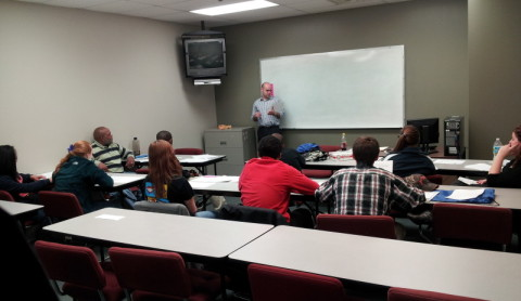 Kohls Manager Brian Ballinger speaking to the students
