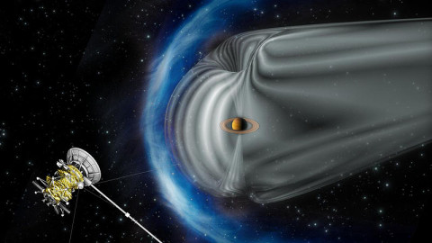 This artist's impression by the European Space Agency shows NASA's Cassini spacecraft exploring the magnetic environment of Saturn. (Image credit: ESA)