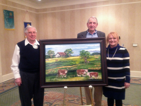 Tracy Jackson, President of the Clarksville Rotary Club, John Bartee, Montgomery County Ag-Extension Director and Lynne Griffey local Artist. Mrs. Griffey was commissioned to paint this year's original piece to be auctioned at the 48th annual Rotary Auction Dinner