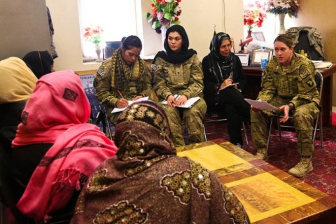 1st Brigade Combat Team, 101st Airborne Division Female Engagement Team members Spc. Samantha Banda, from La Feria, Texas, Spc. Bianca Roig from Eagle Pass, Texas, and Sgt. Stacey Coffield from Orange County, Calif. discuss a variety of issues with female members of the Afghan Uniformed Police and Afghan Border Patrol at the ABP compound in Jalalabad, Afghanistan, Jan. 18th, 2013. (U.S. Army photo by Sgt. 1st Class John D. Brown, TF 1-101 Public Affairs)