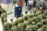 Madeline Cox addressing her dad Lt. Col. Clint Cox and the returning soldiers