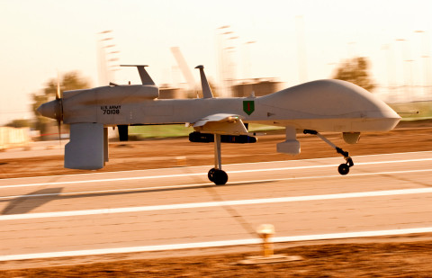 "An MQ-1C Gray Eagle unmanned aircraft makes its way down an airfield on Camp Taji, Iraq, before a surveillance mission in the Baghdad area. The Gray Eagle is the Army's newest ""eyes in the sky,"" and is being tested by Quick Reaction Capability 1-Reaction 1, the only unit using the aircraft in Iraq. (U.S. Army photo by Spc. Roland Hale, eCAB, 1st Inf. Div. PAO)"
