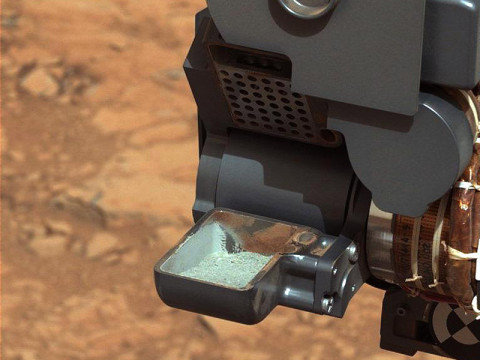 This image from NASA's Curiosity rover shows the first sample of powdered rock extracted by the rover's drill. (Image credit: NASA/JPL-Caltech/MSSS)