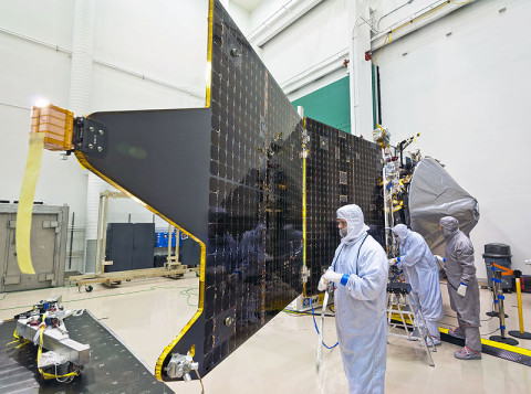 NASA's MAVEN spacecraft recently completed assembly and has started environmental testing. In the Multipurpose Test Facility clean room at Lockheed Martin, technicians installed the orbiter's two solar arrays prior to a modal test. (Credit: Lockheed Martin)