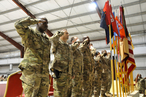 The official party for the Task Force Taskmaster NCO Induction Ceremony, 426th Brigade Support Battalion, 1st Brigade Combat Team, 101st Airborne Division, renders a salute to the colors during the playing of the National Anthem at Jalalabad Airfield, Afghanistan, Feb. 6, 2013. (Sgt. 1st Class John D. Brown/U.S. Army)