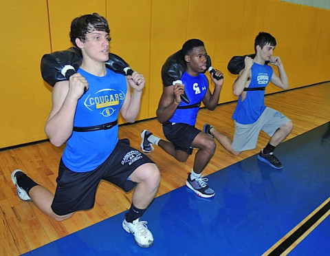 Junior Connor Wise, Sophomores Josh Anderson & Jacob Morton work hard during spring conditioning at Clarksville Academy.  The Polar GX Cardio band monitors their progress as the workout intensifies.