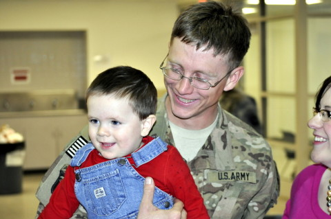 A Soldier assigned to Company A, 1st Battalion, 187th Infantry Regiment, 3rd Brigade Combat Team, 101st Airborne Division (Air Assault) embraces his son Feb. 1 at the Fort Campbell, Ky. Passenger Processing Center after he returned from a deployment to Afghanistan in support of Operation Enduring Freedom. Originally scheduled for a nine month deployment, the company returned after only five months due to the progress made by Afghan National Security Forces in their area of responsibility. (Sgt. Keith Rogers/U.S. Army)