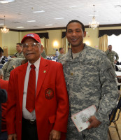 Reverend John Jones of Lumberton, N.C. attended the 8th Military Information Support Group (Airborne) event during the African American Heritage Observance program at the Fort Bragg Club. Joining Rev. Jones is his son, Courtney, a major in the Military Information Support Operations Command. (Photo by Jerry Green, USASOC Public Affairs)