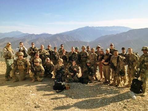 Members of Combined Team Bastogne, 1st Brigade Combat Team, 101st Airborne Division and Provincial Reconstruction Team Kunar pose for a photo Jan. 24th, 2013, after completing the treacherous hike to the top of Observation Point Bull Run near Camp Wright and Asadabad, the capital city of Kunar Province, Afghanistan. (Courtesy photo by U.S. Army 1st Lt. Lisa Maginot, Task Force 426)