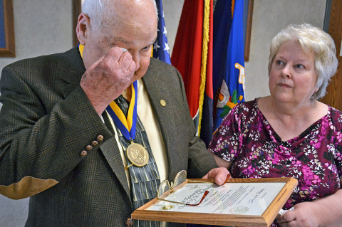 "Retired Platoon Sgt. Cecil Wiggins expresses emotional gratitude as his wife, Gwen, looks on after receiving the Order of St. Michael Bronze Award during a ceremony here Feb. 22. The award lauds the leadership skills he used to turn around the production and morale of the 507th Transportation Company Detachment, attached to the ""Condors,"" Company C, 2nd Squadron, 17th Cavalry Regiment, 101st Airborne Division, during the Vietnam War. (U.S. Army photo by Spc. Jennifer Andersson, 159th Combat Aviation Brigade Public Affairs)"