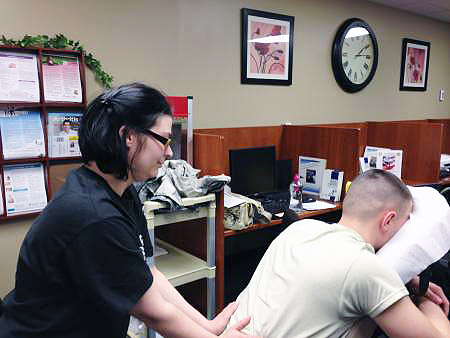 """Massage therapy student Casey Rockwell performed """"Wellness Massages"""" to BACH patients Friday, Feb. 8th in honor of Patient Recognition Month. James Watkins was appreciative of her volunteering her time to help patients relieve tension. (Courtesy photo from BACH staff member Teresa Ratliff)"""